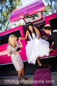 Beautiful bride receiving Chauffeur assistance on her wedding day in the Pink Limo Perth.